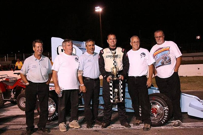 Rhonda Costa/Nevada AppealThe S&S Motorsports team including driver Troy Regier, center with trophy, celebrates in Winner's Circle Saturday at Madera Speedway in Madera, Calif. after winning the Annual Harvest Classic.