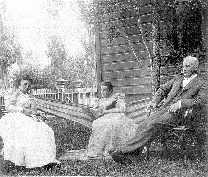 Courtesy of the R. K. Colcord CollectionGov.  Roswell Colcord sits at home on a summer afternoon with his wife, Mary, left, and daughter, Stella.
