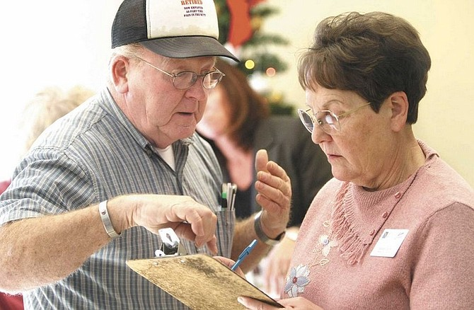 Cathleen Allison/Nevada AppealRenate Daniels, a Medicare S.H.I.P. volunteer, talks with Jerry Welch on Tuesday during an event at the Carson CIty Senior Citizen Center to help seniors navagate the Medicare and Medicade programs.
