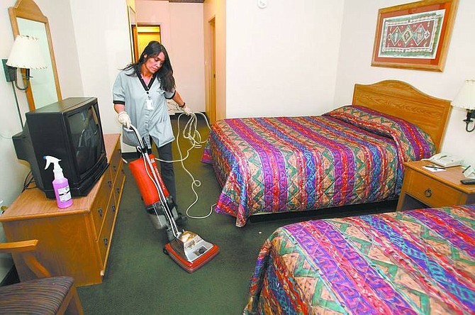 Cathleen Allison/Nevada Appeal  Gold Dust West housekeeper Terry Smith cleans a room Friday morning at the the East Carson City hotel. City businesses and officials are skeptical of a proposal that would increase room taxes to help fund state education.