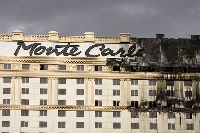 Eric Jamison/AP photoFire damage is shown on the facade of the Monte Carlo hotel and casino in Las Vegas on Friday. The fire broke out on the roof and quickly spread, forcing guests and employees to flee before firefighters got the upper hand, officials said.
