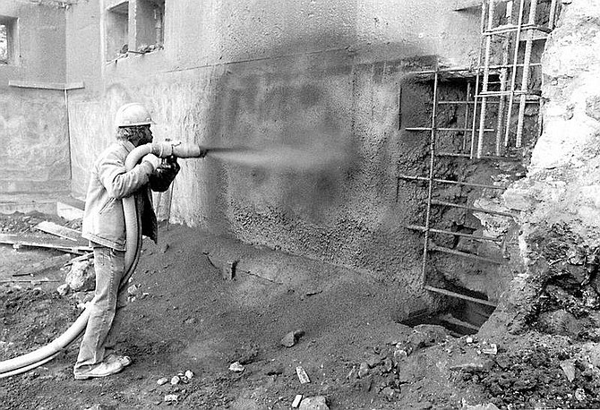 Nevada State Archives A man sprays gunite, a form of concrete, onto steel reinforcing to create a concrete building within a building to protect the Capitol, right, from earthquakes in the 1970s.