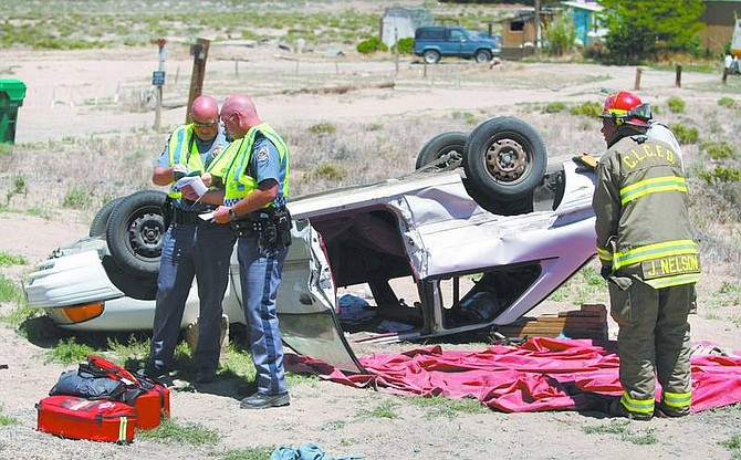 Cathleen Allison/Nevada Appeal Two Silver Springs residents were taken by Care Flight to a Reno hospital following an accident on Highway 95A near Ramsey Weeks Cutoff.