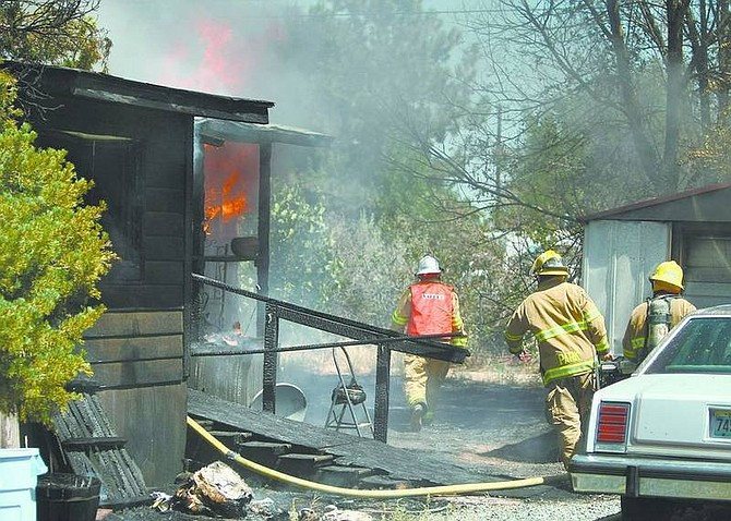 Cathleen Allison/Nevada AppealA Carson City man's home was destroyed by fire Wednesday on Bel Aire Way. Investigators believe the fire was possibly started when the hot-water heater exploded.