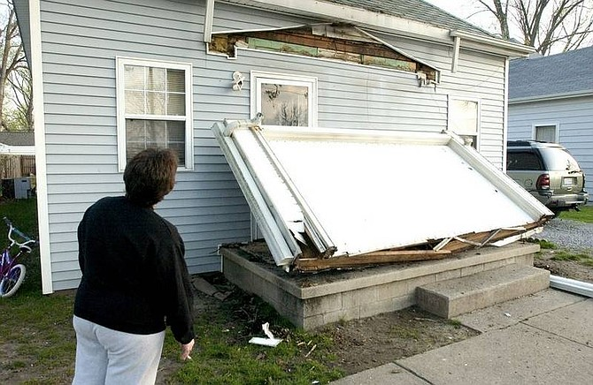 AP Photo/Daniel R. PatmoreJanet Clem, 37, looks at the damage to her home in Mt. Carmel, Ill. Friday morning April 18, 2008 after the 5.2 early morning earthquake.