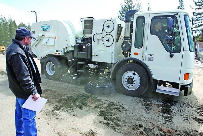 Jen Schmidt/Nevada Appeal News Service Tymco representative Bob Hatfield watches his company's street sweeping unit clean up the parking lot at the Washoe County Roads Department building in Incline Village.