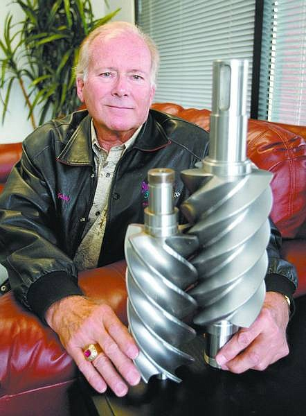 Cathleen Allison/Nevada Appeal Richard Langson, founder of ElectraTherm, displays an example of twin screws for the turbines in the units his company makes that capture excess industrial heat and use it to produce electricity.