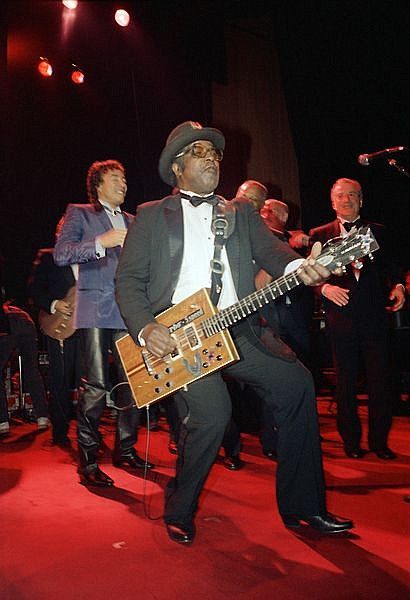 ** FILE ** In this Jan. 21, 1987 file photo rock 'n' roll singer and guitarist Bo Diddley jams with some of the other inductees at the Rock and Roll  Hall of Fame inductee ceremony in New York.  At left is Smokey Robinson. Diddley died Monday June 2, 2008 of heart failure at his home in Archer, Fla., spokeswoman Susan Clary said. He was 79. (AP Photo/Ron Frehm)