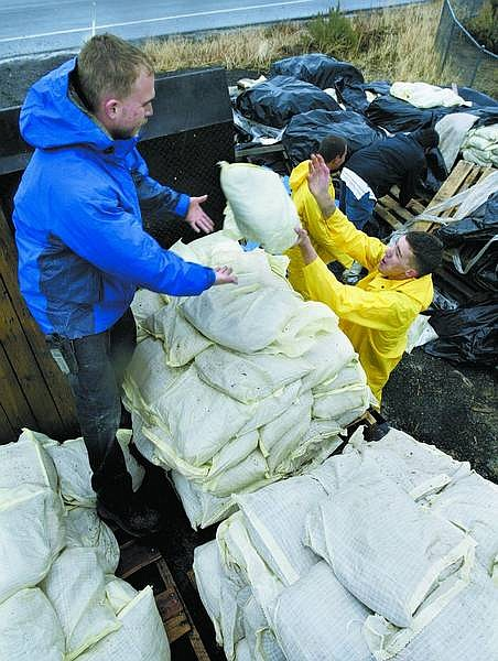 Nevada Appeal File Photo State workers load sandbags in the rain near Ormsby Boulevard in preparation of anticipated flooding during the winter of 2006. The bags were delivered to flood-prone areas in Carson City.
