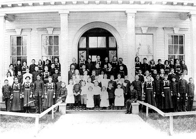 Courtesy Nevada State Library and Archives The first orphanage built in 1873 in Carson City is seen with the children standing out front.