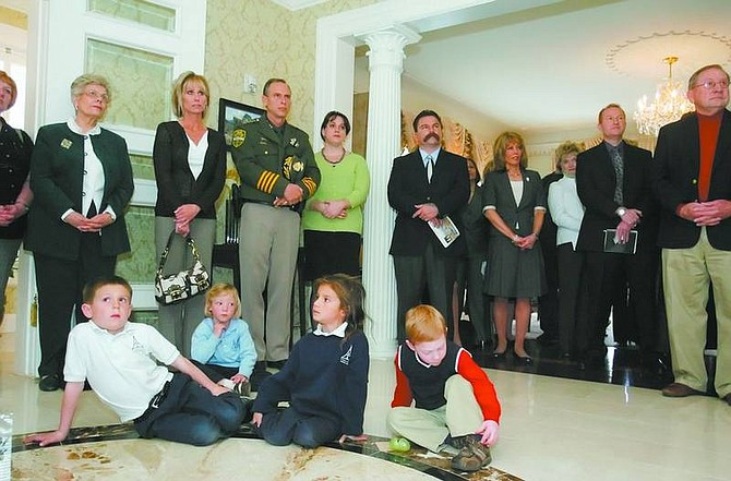 BRAD HORN/Nevada Appeal Mitchell Krivan, from left to right on floor, Madeline Clemens, 6, Madison Krivan, 5, and Dylan Gaylor, 4, listen during a press conference concerning 'Crystal Darkness' at the Governor's Mansion on Thursday.