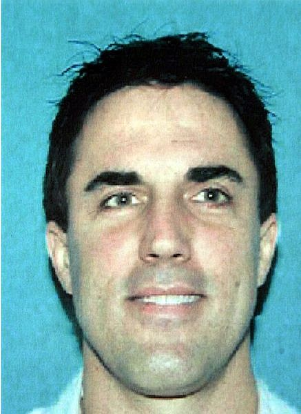 "The Reno Police Department released this undated handout photo of Darren Mack, whom they are calling a ""person of interest' in the shooting of a family court judge, Monday, June 12, 2006, in Reno, Nev. Judge Chuck Weller was shot in the chest  by a shot or shots that came through his office window at the Mill B. Lane Justice Center. He was taken by ambulance to a hospital, where he was reported in serious condition. (AP Photo/Reno Police Department)"