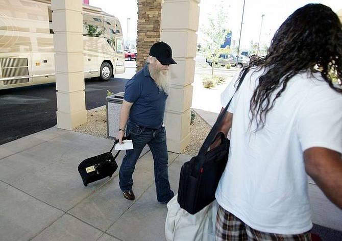 BRAD HORN/Nevada Appeal Members of the band ZZ Top arrive at the Courtyard Marriott in Carson City Monday morning. The band is on a layover from southern California to Nampa, Idaho.