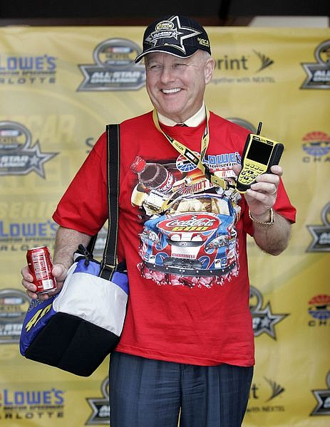 ** FILE ** In this May 15, 2006 file photo, Humpy Wheeler, president and general manager of  Lowe's Motor Speedway, dresses as a NASCAR fan before making his annual prediction, at Lowes Motor Speedway in Charlotte, N.C. Humpy Wheeler has stepped down as president and general manager of Lowe's Motor Speedway, ending a 33-year career as one of NASCAR's top promoters. Wheeler announced his retirement Wednesday May 21, 2008. (AP Photo/Rusty Burroughs, file)