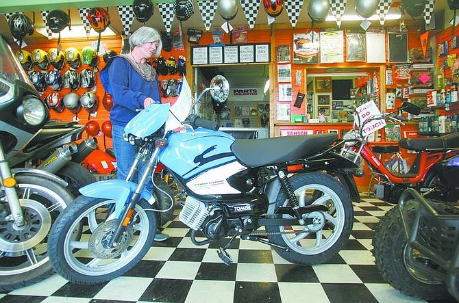 BRAD HORN/Nevada Appeal Diana Cranston, owner of DC Motor Sports, says that the Tomos Streetmate R is one of the more popular mopeds offered at her Carson City shop on Friday.