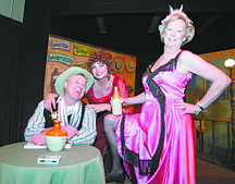 """Brad Horn/Nevada AppealThe villainous Sheriff Amos Crutchwaffle, left, played by Mark McGyver, Belle the owner of the saloon, played by Jan Duke, and April the bar maid, played by Sue Volz, rehearse for the Misfits Theater Group's performance of """"Showdown at the Phingerdoo."""""""