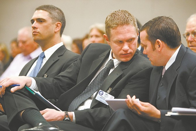 Governor's staff, from left, Chief of Staff Josh Hicks, Legal Counsel Chris Nielsen, and Nick Vander Poel, director of the state Office of Energy, talk Friday, April 10, 2009, during a hearing at the Legislature in Carson City, Nev. About 200 bills and resolutions died Friday as another session deadline passed. (AP Photo/Nevada Appeal, Cathleen Allison)
