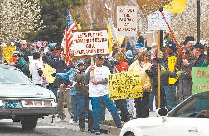 "An estimated 1,500 protesters showed up Wednesday, April 15, 2009, at the Legislature in Carson City, Nev. ""Tax day tea party"" events were held around the country as part of a national protest on tax day. (AP Photo/Nevada Appeal, Cathleen Allison)"