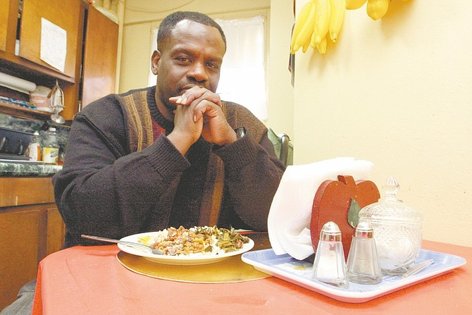In this photo taken Thursday April 16, 2009, Herbert Smith Jr. poses with his meal at home in New York. The 54-year-old Smith has high blood pressure and needs to limit the amount of salt that he eats. He supports a New York City health department campaign to get the food industry and restaurants to cut back on the salt they put in their products. (AP Photo/Tina Fineberg)