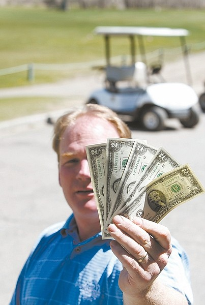 Shannon Litz/Nevada Appeal News ServiceCarson Valley Golf Course owner Tom Brooks with some $2 bills.