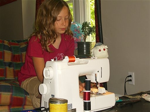 """This photo taken Aug. 17, 2009 shows Sophie Allen,11, sewing in her Boise,Idaho home.  Until recent decades, """"there wasn't this idea that parents should be intervening constantly to make things a teachable moment and expand their minds,"""" said Stephanie Coontz, who teaches history and family studies at The Evergreen State College in Olympia, Wash.. """"Their minds expand a lot better when they pursue things they're interested in for themselves."""" (AP Photo/Anne Wallace Allen)"""