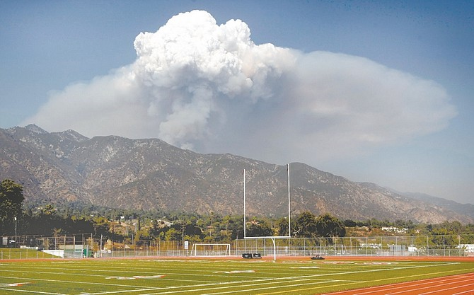A could of vapor and smoke is seen from Victory Park near Pasadena, as the Station Fire continues to burn on the East side of the the Angeles National Forest, Friday, Sept 4, 2009, north of Los Angeles. The fire continued burning as it spread slowly into the east remote San Gabriel Wilderness. (AP Photo/Damian Dovarganes)