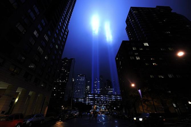 The September 11, 2001 memorial light shines Friday, Sept. 11, 2009 in New York. (AP Photo/Stephen Chernin)