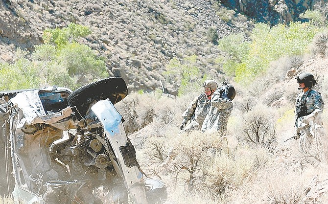 Nevada National Guard members performed a training exercise Friday that included the removal of 20 illegally dumped cars from the Carson River.