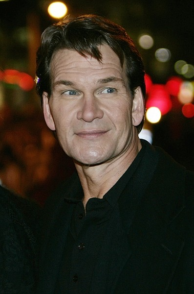 "FILE -  In this Nov. 28, 2005 file photo, actor Patrick Swayze poses for the photographers, prior to the premiere of his new film ""Keeping Mum"" at a Leicester Square cinema in central London. Swayze's publicist Annett Wolf says the 57-year-old ""Dirty Dancing"" actor died Monday, Sept. 14, 2009, after a nearly two-year battle with pancreatic cancer. (AP Photo/Lefteris Pitarakis, file)"
