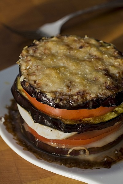 This photo taken Aug, 6, 2009 shows grilled eggplant parmesan. Grilled Eggplant Parmesan lets the great taste of the eggplant really come through. The individual servings look to late season tomatoes to replace the often dominating tomato sauce. (AP Photo/Larry Crowe)