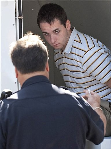 Raymond Clark III,  24, is lead into court in New Haven, Conn. on Thursday, Sept. 17, 2009 for his arraignment. Clark was arrested Thursday at a hotel and charged with murdering Le, whose body was found stuffed in the wall of a research building on what would have been her wedding day. (AP Photo/Douglas Healey).