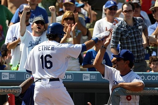 ** CORRECTS SPELLING TO ETHIER ** Los Angeles Dodgers Andre Ethier (16) high fives hitting coach Don Mattingly after a two-run home run off San Francisco Giants starting pitcher Tim Lincecum in the third inning of a baseball game on Sunday, Sept. 20, 2009, in Los Angeles. (AP Photo/Keith Birmingham)