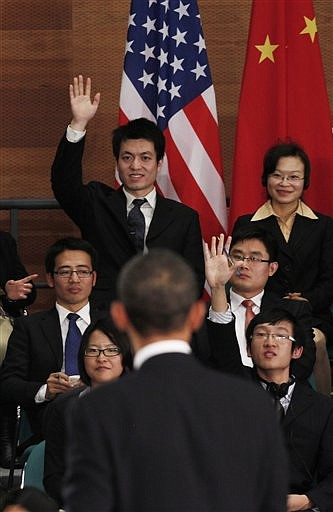 U.S. President Barack Obama looks to take a question at a town hall-style event with Chinese youth at the Museum of Science and Technology in Shanghai, Monday, Nov. 16, 2009. (AP Photo/Charles Dharapak)