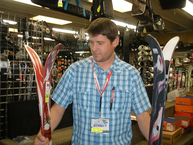 Sam Bauman/For the Nevada AppealJoe Shecher, ski tech at Bobo's Ski shop in Reno, holds two examples of the new rocker type skis; the K2 Pontoon is already a solid seller and the Rossignal Barrar7 is another popular rocket ski.