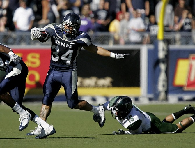 Nevada's Vai Taua (34) runs during an NCAA college football game against Hawaii at Mackay Stadium in Reno, Nev. on Saturday, Oct. 31, 2009. (AP Photo/Brad Horn)