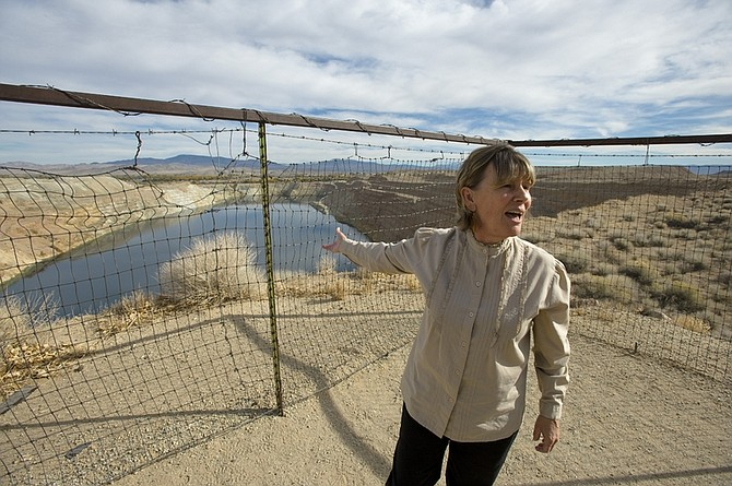 In this photo taken Oct. 26, 2009,Peggy Pauley who formed Yearington's first citizen advocacy group to address the water contamination from the former Anaconda copper mine site near Yearington, Nev., talks about attempts to make a recreation site out of the mine's pit. After decades of state and mine officials claiming that radiation and arsenic contamination in the local wells occurred naturally, scientists have mapped out a definitive uranium plume drifting from the mine site in the local groundwater. (AP Photo/Scott Sady)