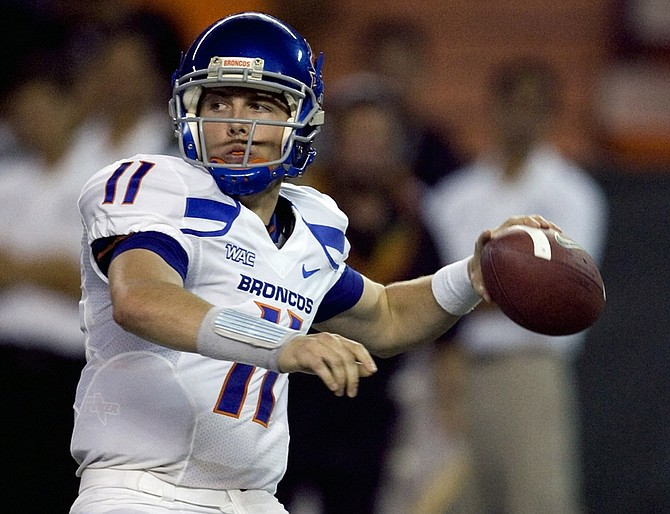FILE - In this Oct. 24, 2009, file photo, Boise State quarterback Kellen Moore throws a pass during the second quarter of an NCAA college football game against Hawaii in Honolulu. Boise State plays Nevada on Friday night with the WAC title on the line. (AP Photo/Marco Garcia)