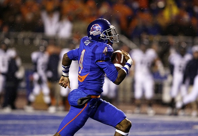 Boise State's Titus Young (4) runs back the opening kickoff for a touchdown against Nevada during the first half of an NCAA college football game on Friday, Nov. 27, 2009, in Boise, Idaho.  (AP Photo/Matt Cilley)