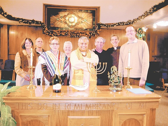 """courtesy photoParticipants in the interfaith prayer service included, from left, Dixie Jennings-Teats, Jeffrey Paul, Myra Soifer, Christie Tews, Rajan Zed, Larry Schneider, Charles T. Durante, and Alan Dorway. Decorations on the table include the Jewish seven-branched candelabrum """"menorah"""" and Hindu god Ganesha."""