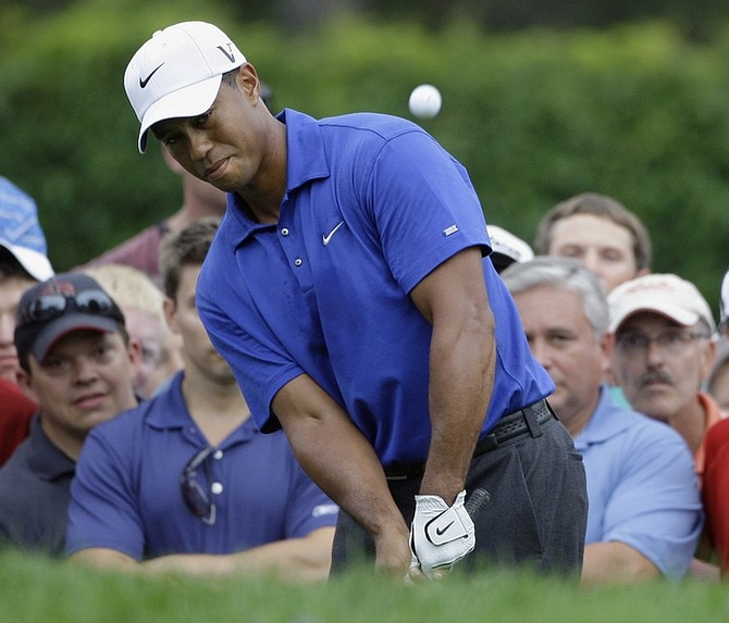 Tiger Woods watches his chip shot to the fifth green during the third round of the 91st PGA Championship at the Hazeltine National Golf Club in Chaska, Minn., Saturday, Aug. 15, 2009. (AP Photo/Morry Gash)