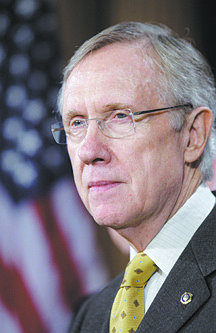 """**ADVANCE FOR MONDAY, DEC. 7** FILE - This Nov. 18, 2009 file photo shows Senate Majority Leader Sen. Harry Reid, D-Nev., pausing during a news conference on health care reform on Capitol Hill in Washington. Reid is a supporter of a federal program that began as a safety net for Pacific Northwest logging communities hard-hit by battles over the spotted owl in the 1990s that has morphed into a sprawling entitlement. Reid called the timber program a personal priority that supports """"the lifeblood of communities all across America, and particularly in the West."""" (AP Photo/Alex Brandon, File)"""