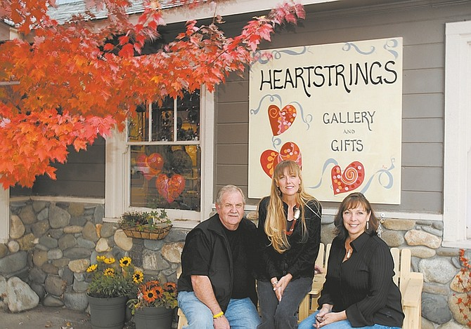 Nevada Appeal News ServiceRichard Farrar, Kim Johnston and Lee Lewis in front of Heartstrings Gallery and Gifts in Minden.