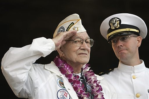 Pearl Harbor survivor Arthur G. Herriford, left, salutes while U.S. Navy Lt. Ben Abney looks on during the ceremony marking the 68th anniversary of the attack at Pearl Harbor, Monday, Dec. 7, 2009 at Pearl Harbor Naval Base in Honolulu.  Herriford served aboard the USS Detroit during the surprise attack in 1941.  AP Photo/Marco Garcia)