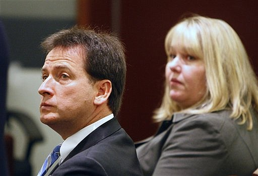 Nevada Lt. Gov. Brian Krolicki, left, and Kathy Besser appear in court, Tuesday, Nov. 24, 2009, in Las Vegas. A clerk said it will be next week before a Nevada judge rules whether to dismiss criminal charges accusing Krolicki and his top aide of mishandling a $3 billion state college savings program. (AP Photo/Las Vegas Review-Journal, John Locher) ** LAS VEGAS SUN OUT. MAGS OUT. NO SALES **
