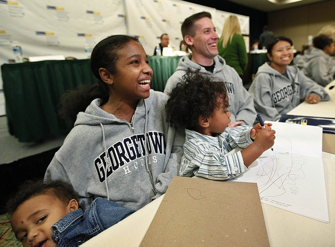 Kidney transplant recipient Roxanne Boyd Williams, second from left, holds her twins Jordan, wearing denim shirt, and Ethan Williams, and recipient Irene Otten, right, and donor Tom Otten, center, during a news conference at Georgetown University Hospital in Washington, Tuesday, Dec. 15, 2009.  The donors are part of a record-setting marathon 13-way kidney swap, a pioneering effort to expand transplants to patients who too often never qualify. Williams received Tom Otten's kidney, while Tom's wife Irene Otten received a kidney from another donor Kelvina Hudgens.  (AP Photo/Manuel Balce Ceneta)