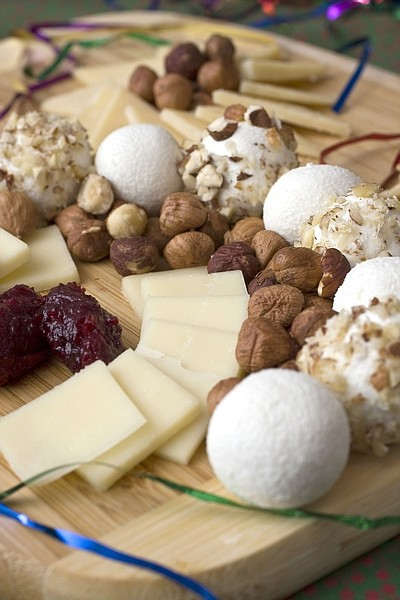This photo taken Nov. 22, 2009 shows a cheese platter. A cheese platter for a holiday gathering can impress with little more effort than the usual cheese cube offering. Offer 3-4 varieties of differing flavors and textures and you will keep your crown happy and satisfied. (AP Photo/Larry Crowe)