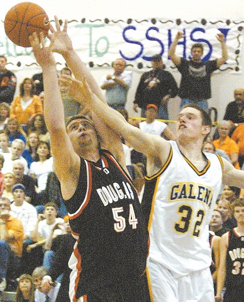 Shannon Litz/Nevada Appeal News ServiceDouglas' Keith Olson battles for a rebound with Galena's Luke Babbitt in 2007. Olson and Babbitt are now teammates for the Nevada Wolf Pack