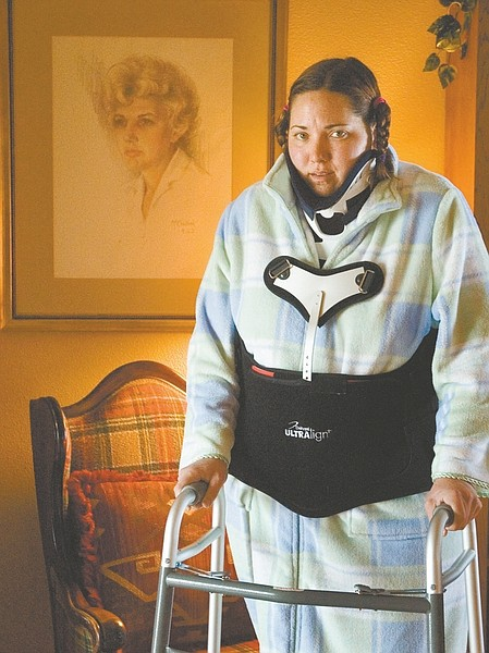 Stephanie Carroll Nevada Apeal News ServiceErica Behimer stands in front of her deceased grandmother's portrait. Behimer said she had visions of her grandmother, Janet Kirch, while waiting to be rescued after a car accident.