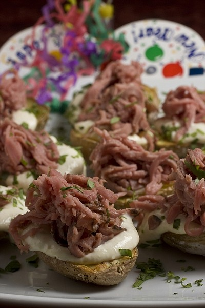 This photo taken Dec. 6, 2009 shows some finger food. These easy to make new potatoes with roast beef and horseradish cream cost half what frozen hors d'oeuvres do and serve nicely with a variety of sliced meat toppings. (AP Photo/Larry Crowe)
