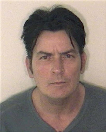 This picture provided by the Aspen Police Department on Friday, Dec. 25, 2009 shows Charlie Sheen. Sheen has been arrested in Aspen, Colo. on charges related to an alleged case of domestic violence. Authorities said Sheen was arrested Friday on charges of second-degree assault as well as menacing, both felonies, and criminal mischief, a misdemeanor. Police said the alleged victim didn't have to be taken to the hospital but didn't identify who the victim was. (AP Photo/Aspen Police Department)